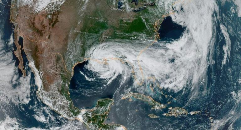 This satellite image obtained from NOAA/RAMMB, shows Tropical Storm Cristobal just south of New Orleans at 19:50 UTC on June 7, 2020, as it moves northward at 12 miles per hour (19 kph)