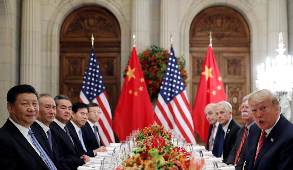 FILE PHOTO: U.S. President Donald Trump, U.S. Secretary of State Mike Pompeo, U.S. President Donald Trump's national security adviser John Bolton and Chinese President Xi Jinping attend a working dinner after the G20 leaders summit in Buenos Aires, Argentina December 1, 2018. REUTERS/Kevin Lamarque/File Photo