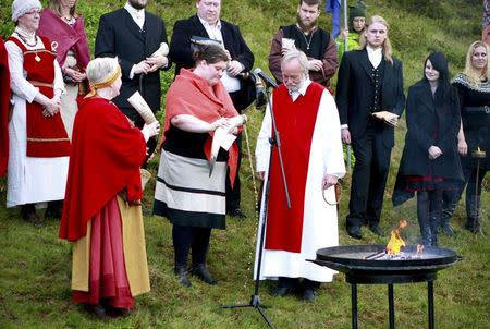 High priest of the Asatru Association, Hilmar Orn Hilmarsson (front right) and fellow members of the Asatru Association, a contemporary Icelandic pagan society attend a ceremony at the Pingvellir National Park near Reykjavik June 21, 2012. REUTERS/Silke Schurack