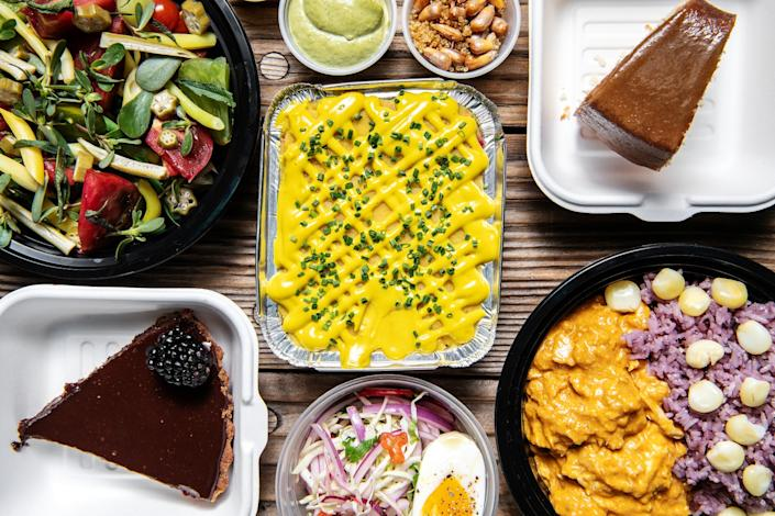 "Aji de gallina (Peruvian chicken stew, right), Grace's caramel poundcake, ganache tart and other dishes from de Porres, a takeout and delivery business run by Danielle Bell and Pablo Osorio. <span class=""copyright"">(Mariah Tauger/Los Angeles Times)</span>"