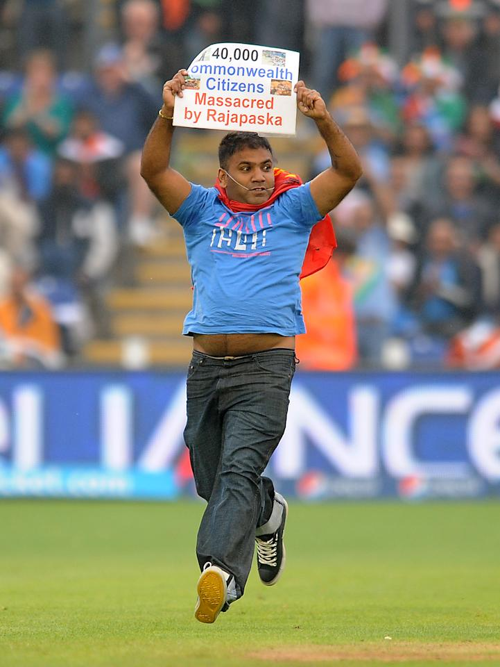 A protester runs onto the pitch during the ICC Champions Trophy, Semi Final at the SWALEC Stadium, Cardiff.