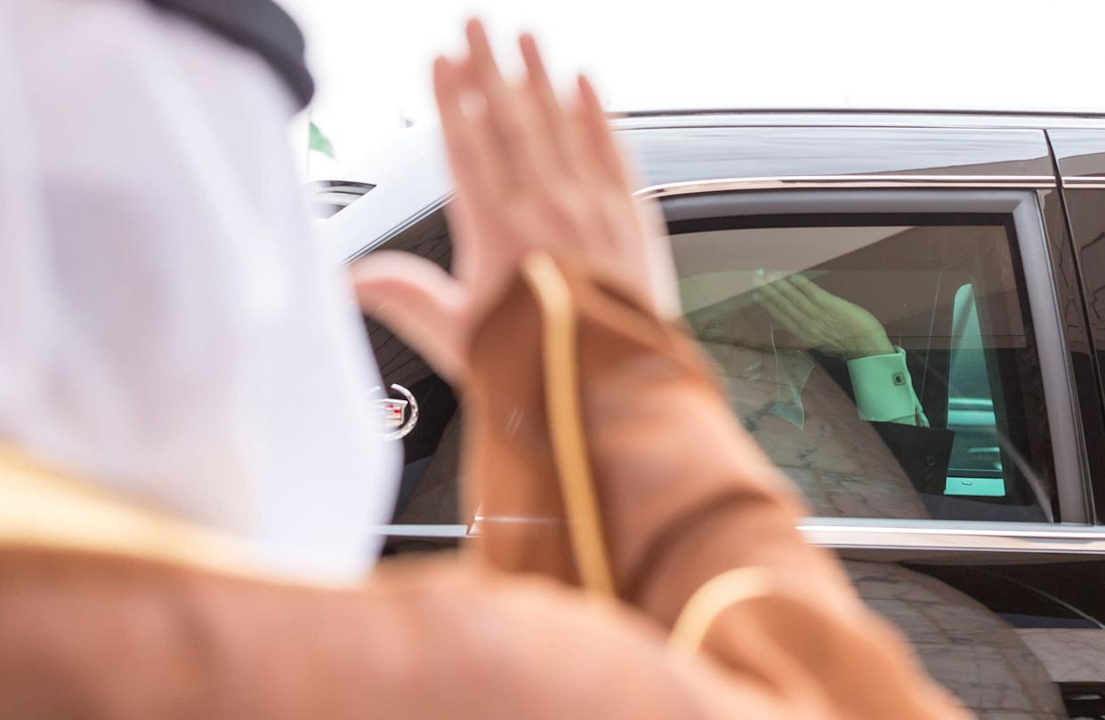 Trump waves from a car during the reception ceremony in Riyadh on May 20, 2017.