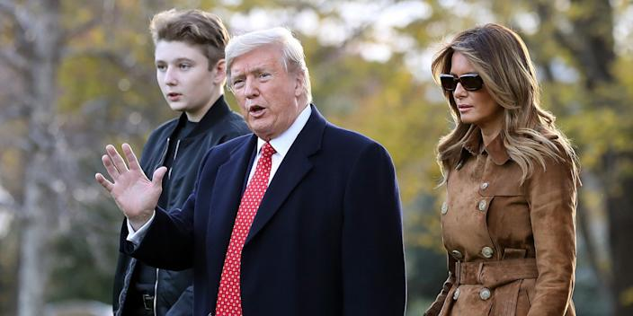 President Donald Trump, first lady Melania Trump and their son Barron Trump walk across the South Lawn before leaving the White House on board Marine One November 26, 2019 in Washington, DC.