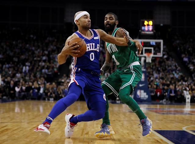 Basketball - NBA - Boston Celtics vs Philadelphia 76ers - O2 Arena, London, Britain - January 11, 2018 Boston Celtics' Kyrie Irving in action with Philadelphia 76ers' Jerryd Bayless REUTERS/Matthew Childs