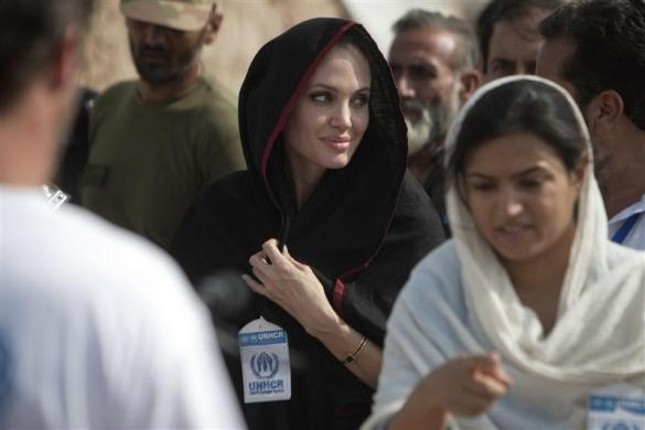 Actress Angelina Jolie (C) arrives at the Jalozai flood victim relief camp during her visit to flood affected areas and relief camps supported by the UNHCR (United Nations High Commissioner for Refugees), in Pakistan's northwest Khyber-Pakhtunkhwa Province, September 7, 2010. Jolie called for constant and long-term assistance for Pakistan to help it cope with its worst ever floods that have wreaked havoc on the impoverished country.