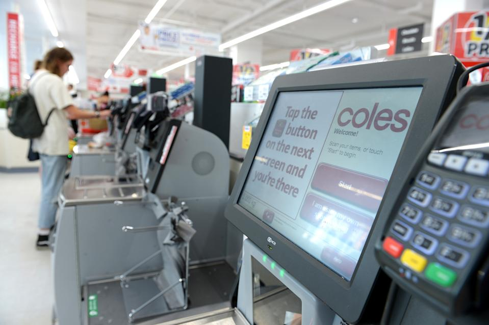 Instructions are displayed on the screen of a self-serve checkout counter in a Coles supermarket. Source: Carla Gottgens/Bloomberg