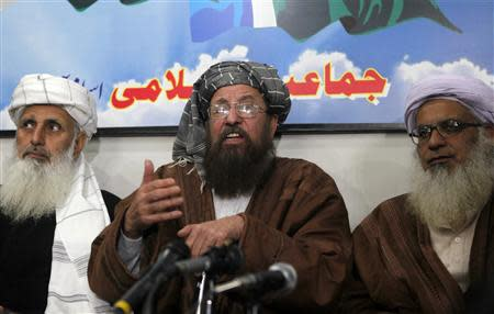 Maulana Sami ul-Haq, one of the Taliban negotiators, speaks during a news conference with his team members Ibrahim Khan and Maulana Abdul Aziz in Islamabad