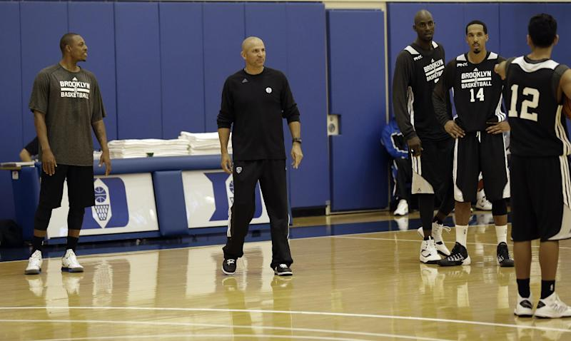 Brooklyn Nets' coach Jason Kidd, second from left, works with players during NBA basketball training camp at Duke University in Durham, N.C., Tuesday, Oct. 1, 2013. (AP Photo/Gerry Broome)