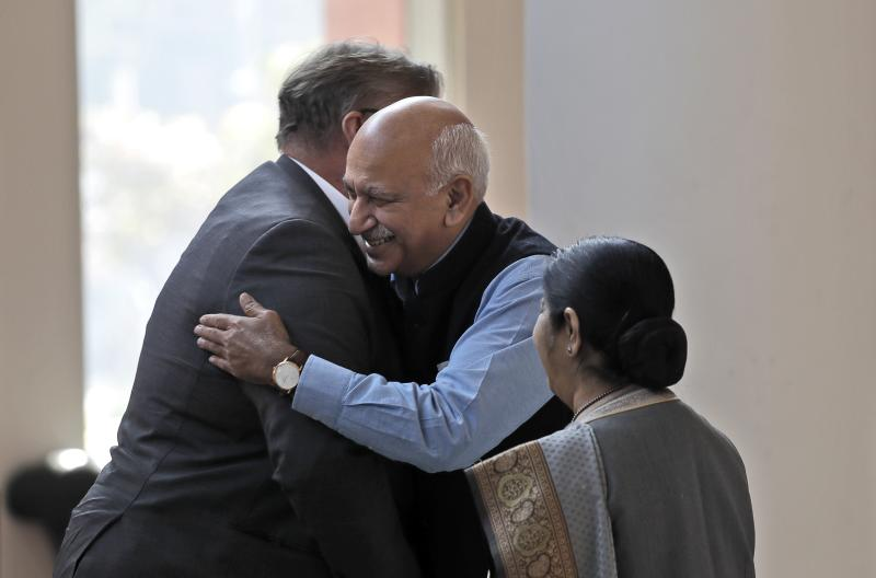FILE - In this Nov. 24, 2017 file photo, Indian Junior Foreign Minister M.J. Akbar, center, hugs Finland's Foreign Minister Timo Soini in New Delhi, India. A complaint by a retired Bollywood actress living in the United States alleging sexual harassment on a 2008 movie set has galvanized women in India, but for the country's burgeoning #MeToo movement to reach broader swaths of society, a little-known labor law must be more aggressively implemented, lawyers and activists said Thursday, Oct. 11, 2018. In less than a week, at least nine women journalists have accused Akbar of sexual harassment and inappropriate behavior when he was a newspaper editor in Kolkata and Delhi. (AP Photo/Manish Swarup, File)