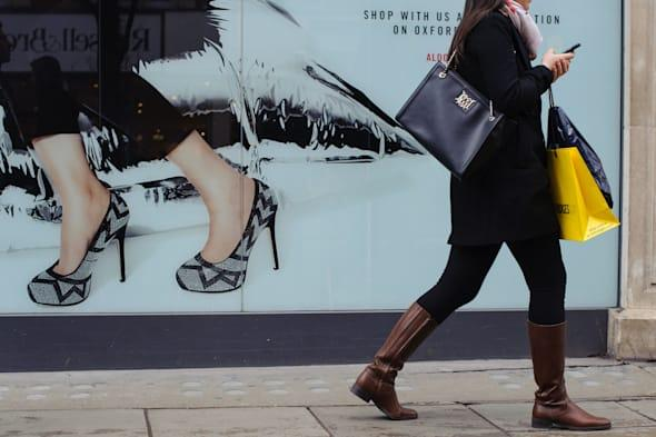 File photo dated 17/01/14 of a shopper on Oxford Street, in central London as retail sales staged a bigger-than-expected bounce-back last month as shoppers returned to the high street after a weather-hit January, according to official figures. PRESS ASSOCIATION Photo. Issue date: Thursday March 27, 2014. The Office for National Statistics (ONS) said sales volumes rose 1.7% month on month in February, smashing forecasts for sales to edge 0.5% higher. It comes after a disappointing January, with the ONS revealing that sales fell even more than first thought, down by 2% against an initial estimate for a 1.5% decline. See PA story ECONOMY Retail. Photo credit should read: Dominic Lipinski/PA Wire