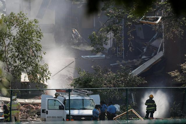 <p>Emergency personnel put water on the scene of school building explosion and collapse at Minnehaha Academy in Minneapolis, Minnesota, August 2, 2017. (Adam Bettcher/Reuters) </p>
