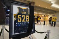 "A jersey honoring Bobby ""Slick"" Leonard is displayed in the lobby before an NBA basketball game between the Indiana Pacers and the Los Angeles Clippers, Tuesday, April 13, 2021, in Indianapolis. The Indiana Pacers announced that the man who led them to three ABA championships during a Hall of Fame coaching career and was selected a 1963 NBA All-Star had died. (AP Photo/Darron Cummings)"