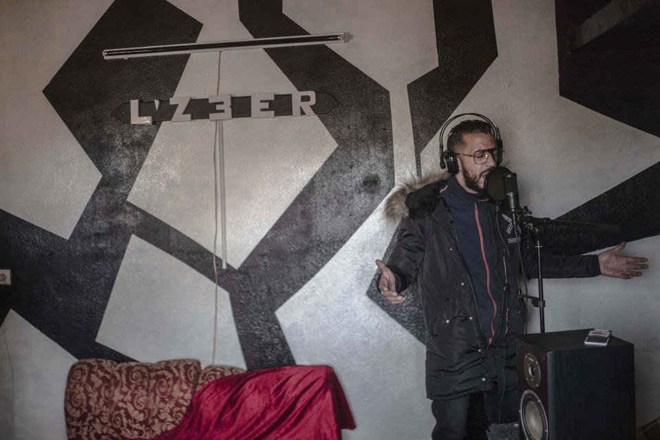 In this Thursday, Nov. 21, 2019 photo, Moroccan rapper Yahya Semlali, 31, known as LZ3er, performs one of his songs during an interview with the Associated Press in his studio in Fes, Morocco. (AP Photo/Mosa'ab Elshamy)