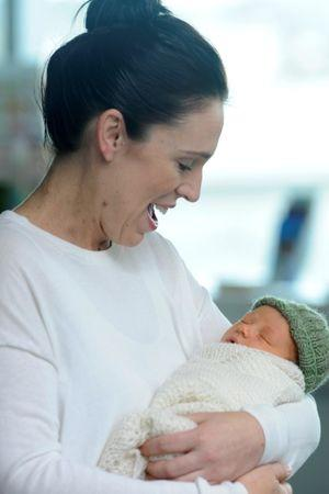 New Zealand Prime Minister Jacinda Ardern carries her newborn baby Neve Te Aroha Ardern Gayford as she walks out of the Auckland Hospital in New Zealand, June 24, 2018.        REUTERS/Ross Land