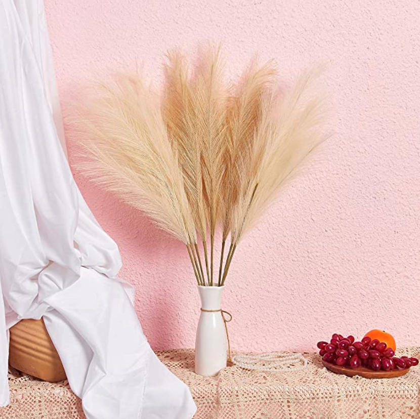 """<h2>Pampas Grass</h2><br>Add some texture to an otherwise bland corner with a large vase full of fluffy pampas grass. <br><br><br><strong>PERFNIQUE</strong> Faux Pampas Grass, $, available at <a href=""""https://amzn.to/3szpK9c"""" rel=""""nofollow noopener"""" target=""""_blank"""" data-ylk=""""slk:Amazon"""" class=""""link rapid-noclick-resp"""">Amazon</a>"""