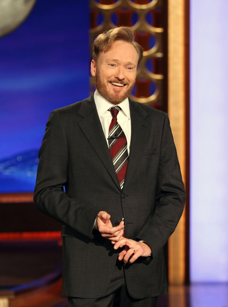 """FILE - In this Nov. 9, 2010 file publicity image originally released by Team Coco, Conan O'Brien speaks during his monologue on """"Conan"""". After two months on the air, O'Brien's late-night talk show is the favorite of younger viewers _ that is, when DVR usage is factored in, according to basic-cable network TBS.(AP Photo/Team Coco, Meghan Sinclair, File)"""