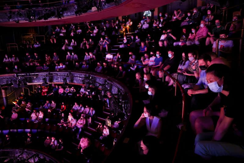 FILE PHOTO: Guests watch a performance of the West End show 'The Show Must Go On' at the Palace Theatre, amid the spread of coronavirus disease (COVID-19) in London