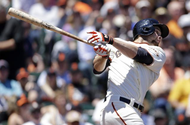 San Francisco Giants' Brandon Belt hits an RBI-single to left field off San Diego Padres starting pitcher Eric Stults during the fourth inning of their baseball game on Wednesday, June 19, 2013, in San Francisco. (AP Photo/Eric Risberg)