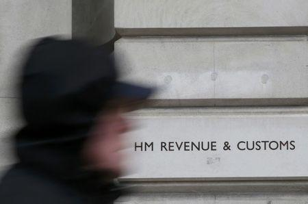 File photo of a pedestrian walking past the headquarters of Her Majesty's Revenue and Customs (HMRC) in central London