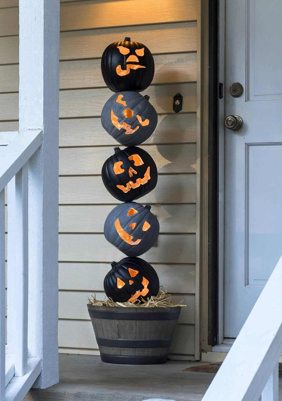 "<p>Stack craft pumpkins on top of each other and fill with twinkle lights for an unexpected, but seriously fun, topiary.</p><p>Get the tutorial at <a href=""https://diycandy.com/lighted-halloween-pumpkin-topiary/"" rel=""nofollow noopener"" target=""_blank"" data-ylk=""slk:DIY Candy"" class=""link rapid-noclick-resp"">DIY Candy</a>.</p>"