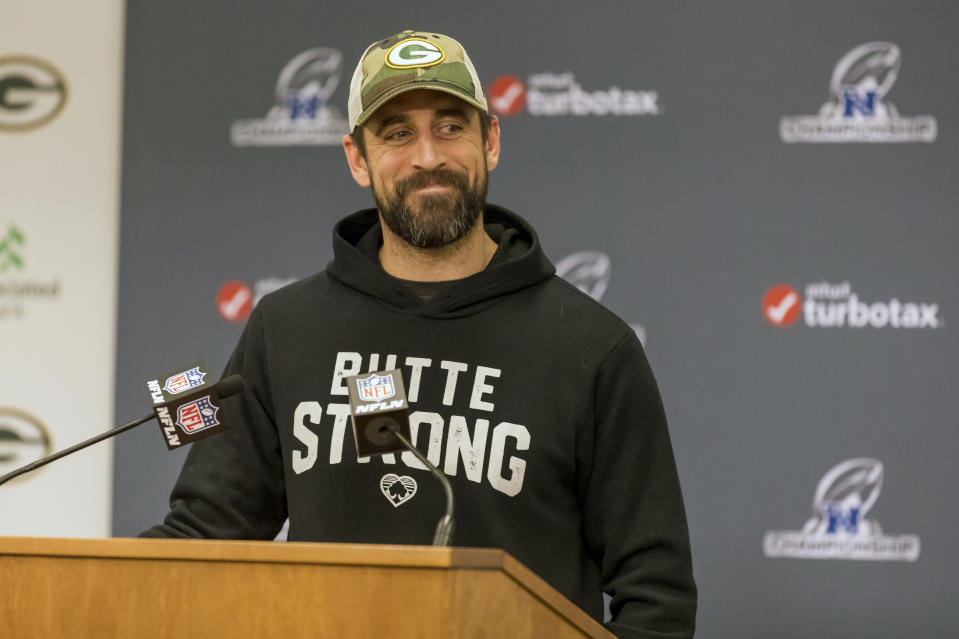 Green Bay Packers quarterback Aaron Rodgers smiles as he answers questions from the media Friday Jan. 17, 2020, in Green Bay, Wis. The Packers will play the San Francisco 49ers in the NFL football NFC Championship game on Sunday. (AP Photo/Mike Roemer)
