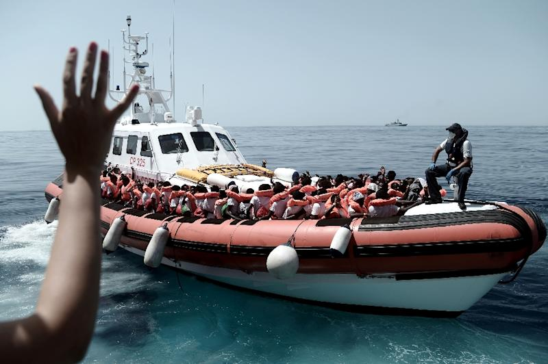 This handout picture from Medecins Sans Frontiers shows rescued migrants onboard an Italian coastguard ship following their transfer from the French NGO's ship Aquarius (AFP Photo/Karpov)