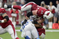 Arizona Cardinals quarterback Kyler Murray is sacked by Detroit Lions outside linebacker Devon Kennard (42) as offensive guard J.R. Sweezy (64) defends during the first half of an NFL football game, Sunday, Sept. 8, 2019, in Glendale, Ariz. (AP Photo/Darryl Webb)