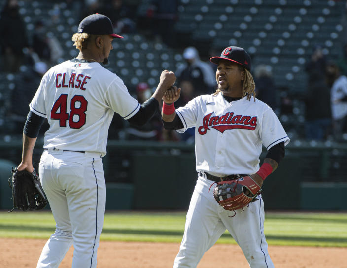 Cleveland Indians' Jose Ramirez, left congratulates closer Emmanuel Clase after a baseball game against the New York Yankees in Cleveland, Sunday, April 25, 2021. Cleveland won 7-3. (AP Photo/Phil Long)
