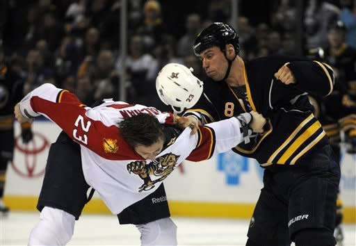 Florida Panthers defenseman Tyson Strachan (23) loses his helmet during a fight with Buffalo Sabres center Cody McCormick (8) during the first period of an NHL hockey game in Buffalo, N.Y., Sunday, Feb. 3, 2013. (AP Photo/Gary Wiepert)