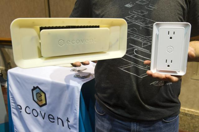 An Ecovent and sensor are displayed during the 2015 International Consumer Electronics Show (CES) in Las Vegas, Nevada January 4, 2015. The system, about $1,800 for a four-bedroom home, can automatically open or close vents for the perfect temperature in a home with central heating and cooling. The system should be available in August of 2015, a representative said. REUTERS/Steve Marcus (UNITED STATES - Tags: SCIENCE TECHNOLOGY BUSINESS)