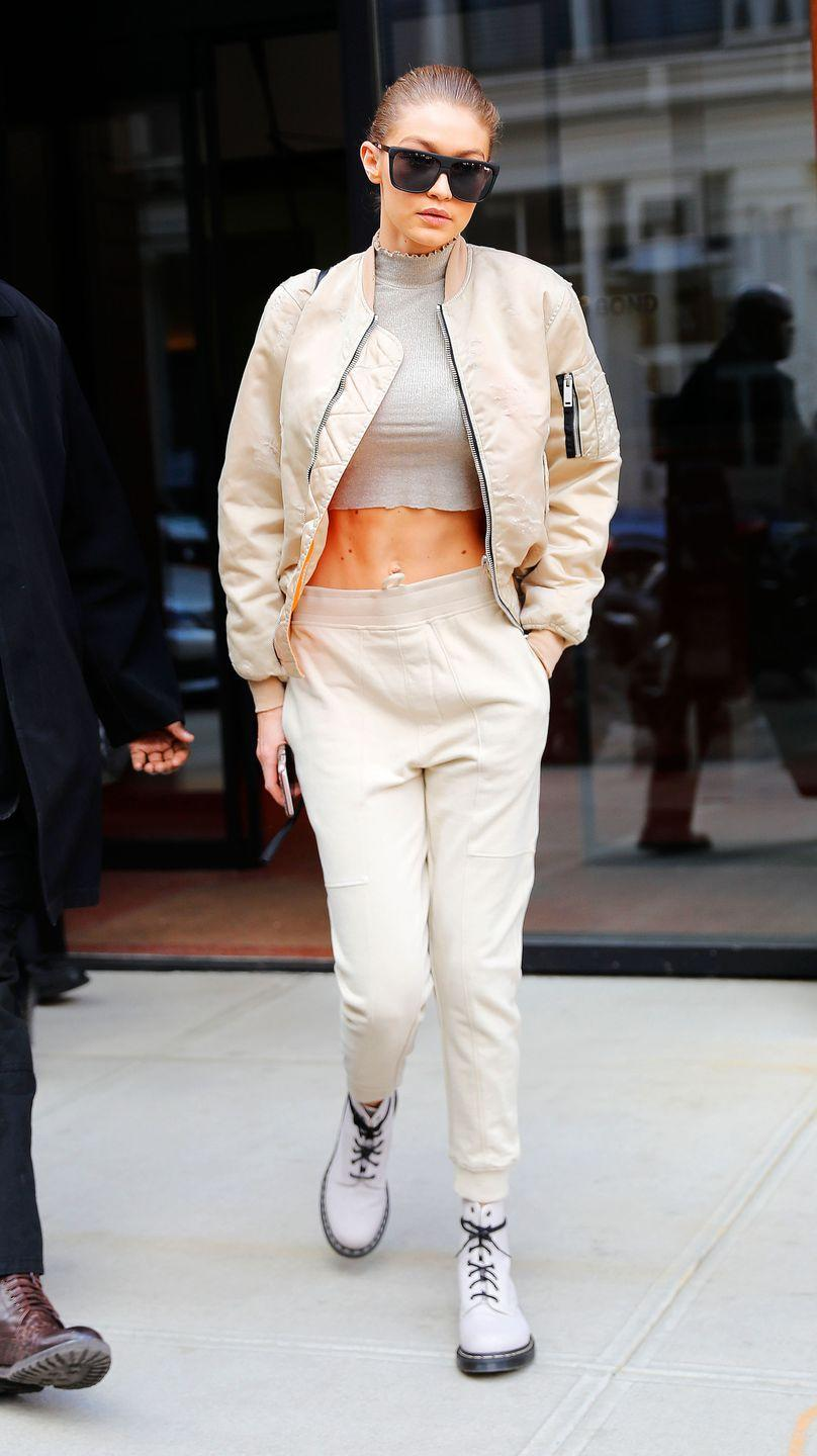 <p>In a Topshop turtleneck (cropped DIY-style), white bomber jacket, white sweats, white combat boots and white Dr. Martens combat boots.</p>