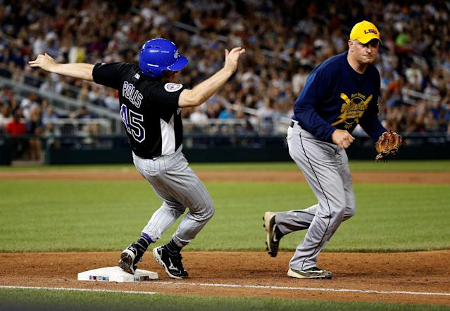 <p>Rep. Jared Polis (D-CO) trips over first base as Rep. Tom Rooney (R-FL) chases the ball during the annual Congressional Baseball Game at Nationals Park in Washington, June 15, 2017. (Photo: Joshua Roberts/Reuters) </p>