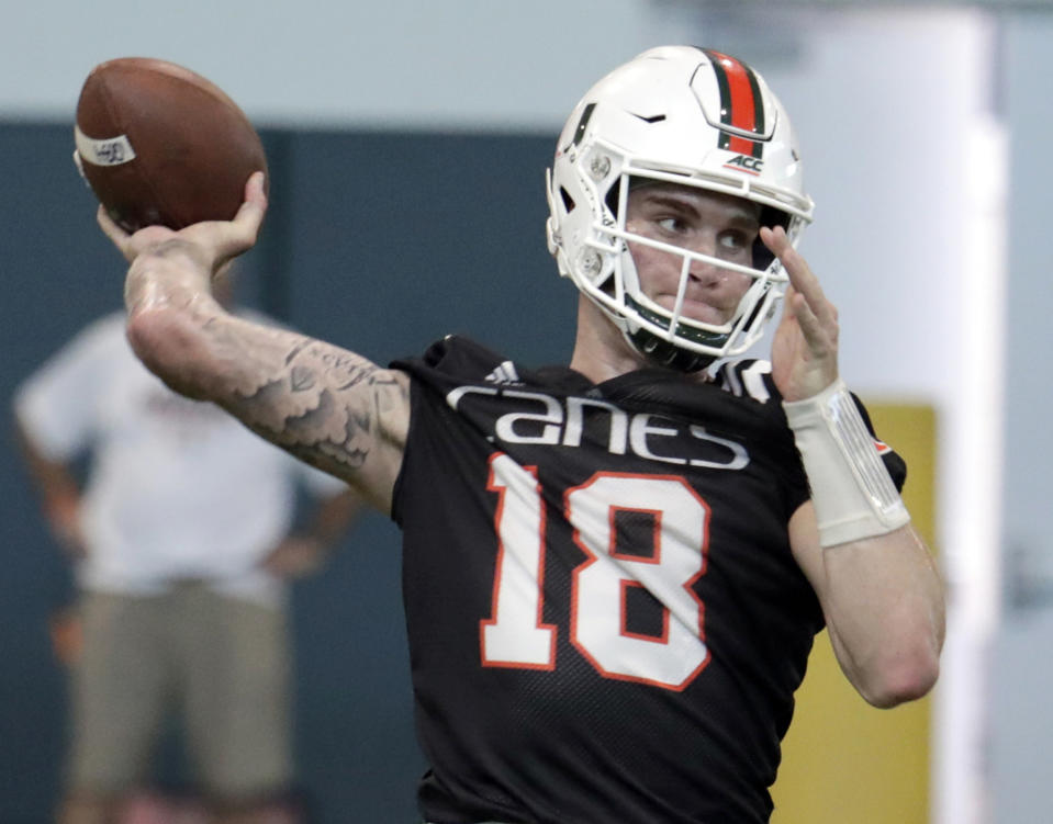 FILE - In this April 18, 2019, file photo, Miami quarterback Tate Martell (18) throws during NCAA college football spring practice, in Coral Gables, Fla. A string of recent high-profile transfers gave the college football world the impression it was getting easier for players to switch schools and compete right away. Martell to Miami, Shea Patterson to Michigan and Justin Field to Ohio State seemed to usher in a new era of free agency, but waiver approvals are still far from a sure thing. That is prompting athletes, coaches and others to complain about a process that can be somewhat mysterious. (AP Photo/Lynne Sladky, File)