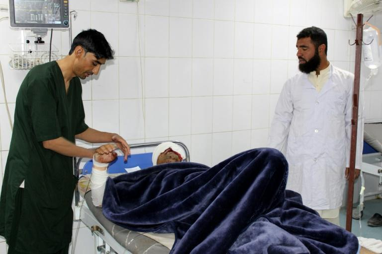 A wounded man receives medical treatment at a hospital after a car bomb attack on an Afghan police base in Khost province