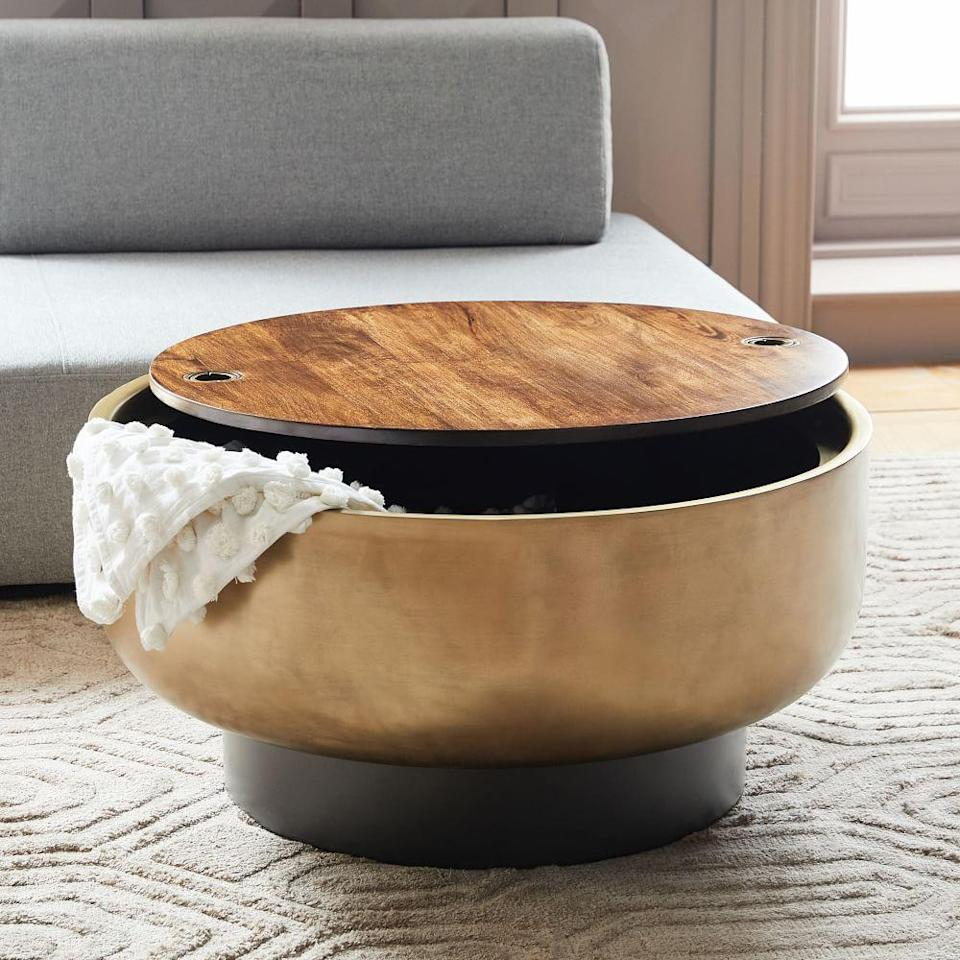 "<h2>West Elm</h2><br>Although West Elm is one of the giants of home goods and modern furniture, it is also home to a wide <a href=""https://www.westelm.com/shop/collaborations/sustainably-sourced/"" rel=""nofollow noopener"" target=""_blank"" data-ylk=""slk:selection of sustainable pieces"" class=""link rapid-noclick-resp"">selection of sustainable pieces</a>. This storage-savvy coffee table is handcrafted, fair trade, and sustainably sourced. <br><br><em>Shop</em> <strong><em><a href=""http://westelm.com"" rel=""nofollow noopener"" target=""_blank"" data-ylk=""slk:West Elm"" class=""link rapid-noclick-resp"">West Elm</a></em></strong><br><br><strong>West Elm</strong> Drum Storage Coffee Table, $, available at <a href=""https://go.skimresources.com/?id=30283X879131&url=https%3A%2F%2Fwww.westelm.com%2Fproducts%2Fdrum-storage-coffee-table-h2557"" rel=""nofollow noopener"" target=""_blank"" data-ylk=""slk:West Elm"" class=""link rapid-noclick-resp"">West Elm</a>"