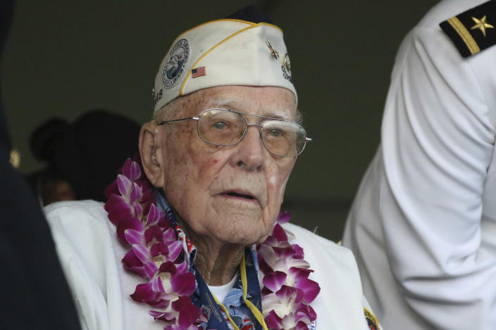 Retired U.S. Navy Cmdr. Don Long listens during a ceremony to mark the 78th anniversary of the Japanese attack on Pearl Harbor, Saturday Dec. 7, 2019 at Pearl Harbor, Hawaii. Long was alone on an anchored military seaplane in the middle of Kaneohe Bay across the island from Pearl Harbor when Japanese warplanes started striking Hawaii on December 7, 1941, watching from afar as the attack that killed and wounded thousands unfolded. The Japanese planes reached his base on Kaneohe Bay soon after Pearl Harbor was hit, and the young sailor saw buildings and planes explode all around him. (AP Photo/Caleb Jones)