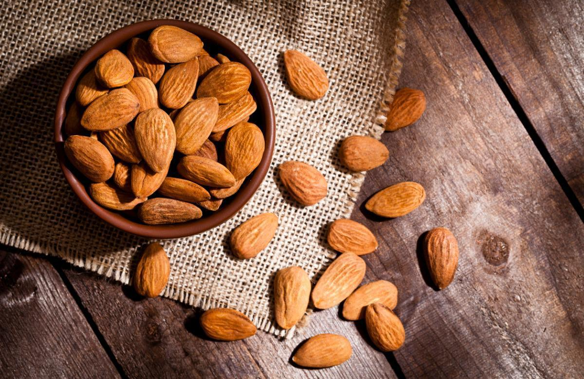 "<p>Native to the Mediterranean, almonds have been around since 3000 B.C. Technically a<a href=""https://www.thedailymeal.com/healthy-eating/almonds-aren-t-nuts-they-re-fruit?referrer=yahoo&category=beauty_food&include_utm=1&utm_medium=referral&utm_source=yahoo&utm_campaign=feed""> </a>fruit, they can help reduce heart disease by lowering cholesterol and <a href=""https://www.thedailymeal.com/healthy-eating/bloat-fighting-foods?referrer=yahoo&category=beauty_food&include_utm=1&utm_medium=referral&utm_source=yahoo&utm_campaign=feed"">promoting anti-inflammation</a>. Great as a stand-alone snack,<a href=""https://www.thedailymeal.com/cook/10-recipes-show-diversity-almonds-slideshow?referrer=yahoo&category=beauty_food&include_utm=1&utm_medium=referral&utm_source=yahoo&utm_campaign=feed""> </a>almonds are also delicious in<a href=""https://www.thedailymeal.com/cook/50-salads-all-seasons-recipes?referrer=yahoo&category=beauty_food&include_utm=1&utm_medium=referral&utm_source=yahoo&utm_campaign=feed""> </a>salads, trail mix and as almond butter.</p>"