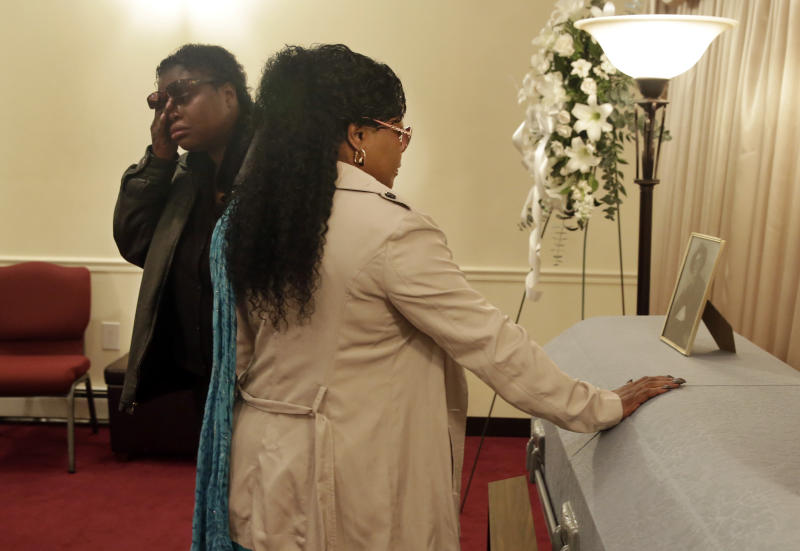 Lakisha Murdough, left, and Cheryl Warner, the daughter and sister of Jerome Murdough, pause at his casket before his funeral at the Cobbs Funeral Chapel, in the Queens borough of New York, Friday, April 25, 2014. A modest family funeral was held for 56-year-old Jerome Murdough, a homeless former Marine who was found dead more than two months ago in an overheated New York City jail cell. (AP Photo/Richard Drew)