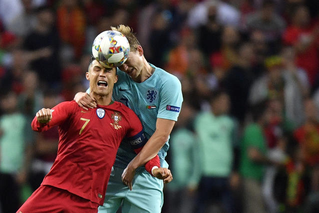 Portugal's Cristiano Ronaldo, left, jumps for the ball with Netherlands' Matthijs de Ligt during the UEFA Nations League final soccer match between Portugal and Netherlands at the Dragao stadium in Porto, Portugal, Sunday, June 9, 2019. (AP Photo/Martin Meissner)