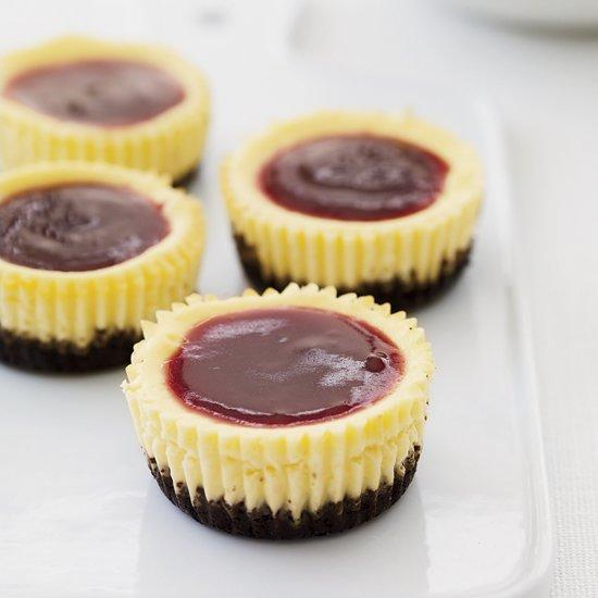 """<p>In these single-serving desserts from Grace Parisi, the rich and creamy cheesecakes are baked atop a chocolate-wafer base. You don't need any special equipment to make them—just a muffin tin and foil liners.</p><p><a href=""""https://www.foodandwine.com/recipes/mini-black-bottom-cheesecakes"""">GO TO RECIPE</a></p>"""