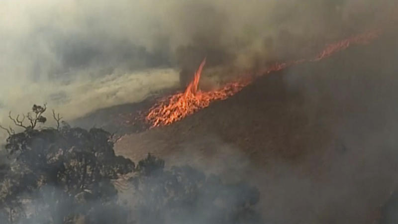 In this aerial image made from video, fire burning in Birdwood, South Australia state, Wednesday, Dec. 25, 2019. South Australia state, which last week had dozens of homes destroyed after wildfires flared in catastrophic conditions, is bracing for a return of extreme temperatures, with Adelaide, the state capital, expected to reach 41 C (106 F) on Saturday.(Australian Broadcasting Corporation, Channel 7, Channel 9 via AP)