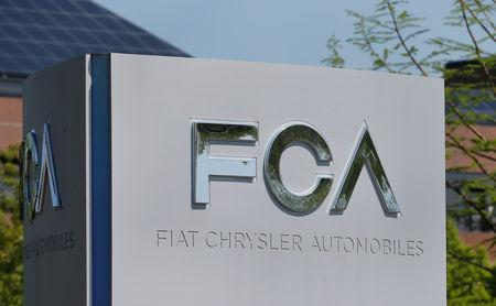 FILE PHOTO: A Fiat Chrysler Automobiles (FCA) sign at its U.S. headquarters in Auburn Hills, Michigan, U.S., May 25, 2018.  REUTERS/Rebecca Cook/File Photo