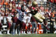Boston College wide receiver Kobay White (9) hauls in a pass against Virginia Tech defensive back Caleb Farley (3) during the first half of an NCAA college football game in Boston, Saturday, Aug. 31, 2019. (AP Photo/Michael Dwyer)