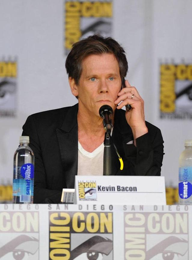 "Kevin Bacon takes a call during ""The Following"" panel on Friday, July 19 during Fox Fanfare At San Diego Comic-Con 2013."