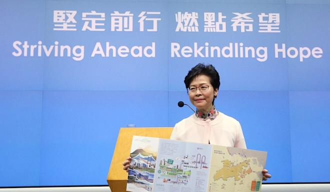 Hong Kong Chief Executive Carrie Lam displays a pamphlet on the Lantau Tomorrow Vision proposal to the press in 2018. Photo: Dickson Lee