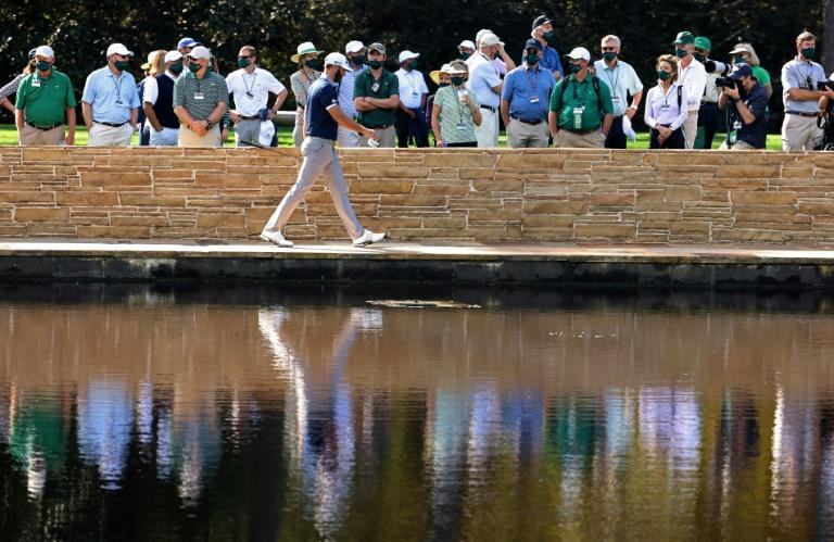 Co-leader: World number one Dustin Johnson of the United States walks across the Sarazen Bridge on the 15th hole during the second round of the Masters at Augusta National