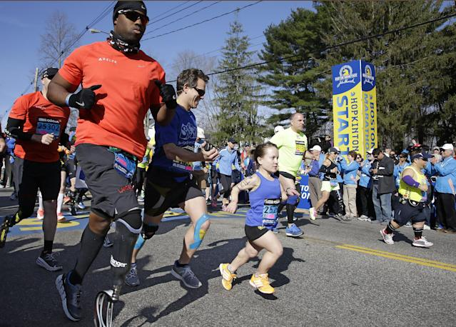 The 118th Boston Marathon gets underway as the mobility impaired runners leave the start line behind Monday, April 21, 2014 in Hopkinton, Mass. (AP Photo/Stephan Savoia)