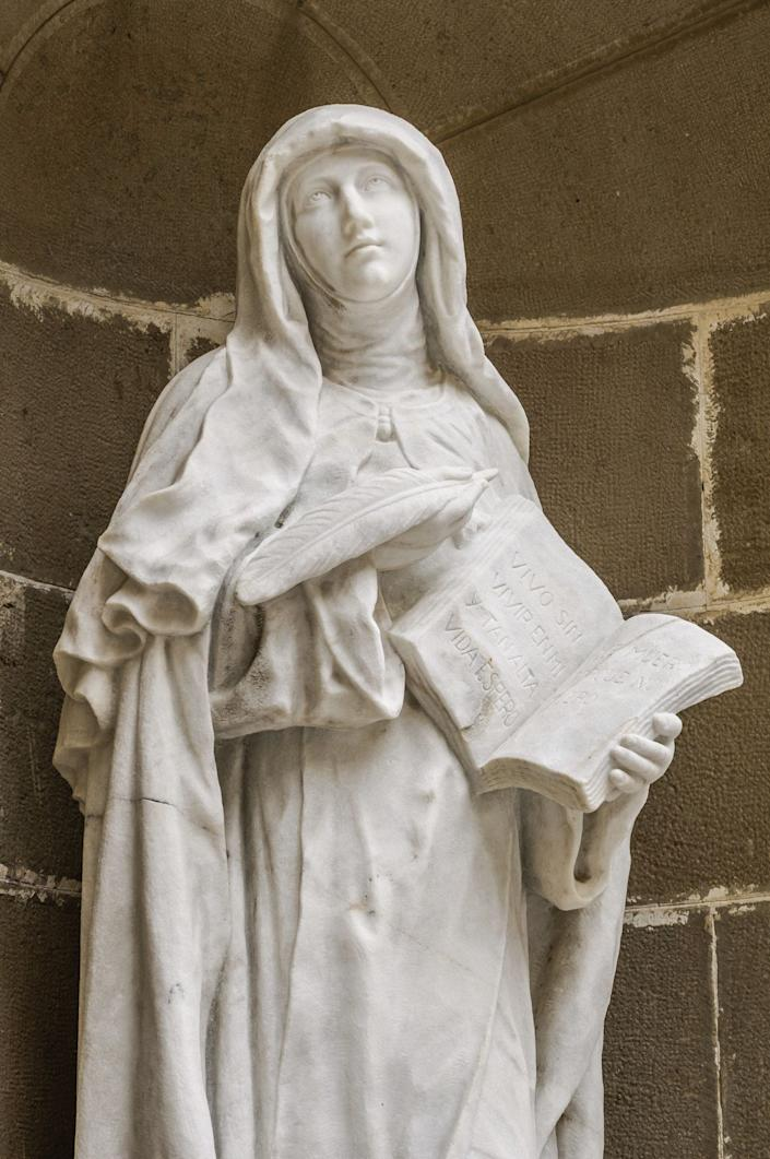 """<a href=""""http://www.ewtn.com/library/MARY/AVILA.htm"""">Teresa of Avila</a>was born in Spain during the 16th century to a well-to-do family. Teresa was fascinated by stories of the Christian saints and martyrs from a young age and explored these interests through mystical games she played with her brother, Roderigo. Her early efforts to join a convent were interrupted by the disapproval of her father, as well as several bouts of malaria. She turned instead to quiet prayer and contemplation and attained what she described in her autobiography as the """"prayer of union,"""" in which she felt her soul absorbed into God's power. She went on to join a convent and was said to have at one point restored her young nephew to health after he was crushed by a fallen wall. The episode was presented at the process for Teresa's canonization, which took place in 1662."""