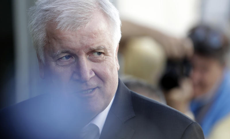 German Interior Minister and chairman of the German Christian Social Union (CDU), Horst Seehofer, speaks as he arrives for a meeting with German Chancellor and chairwoman of the German Christian Democratic Union (CDU), Angela Merkel, in Berlin, Germany, Monday, July 2, 2018. (AP Photo/Michael Sohn)