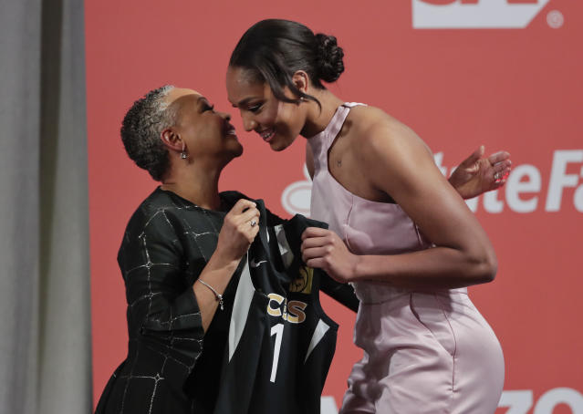 "South Carolina's A'ja Wilson, right, is greeted by WNBA president Lisa Borders after being selected as the No. 1 overall pick in the WNBA basketball draft by the <a class=""link rapid-noclick-resp"" href=""/wnba/teams/sas"" data-ylk=""slk:Las Vegas Aces"">Las Vegas Aces</a>, Thursday, April 12, 2018, in New York. (AP Photo/Julie Jacobson)"